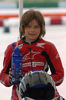 Rossi's brother wins his first race
