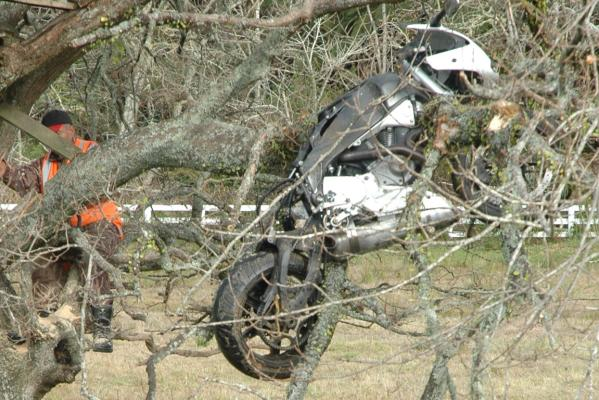 Motorcycle stuck in tree after crash