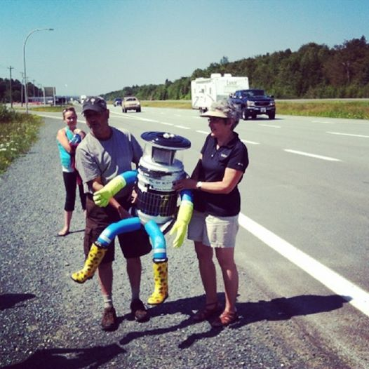 Hitchhiking robot one motorcycle ride away from final destination