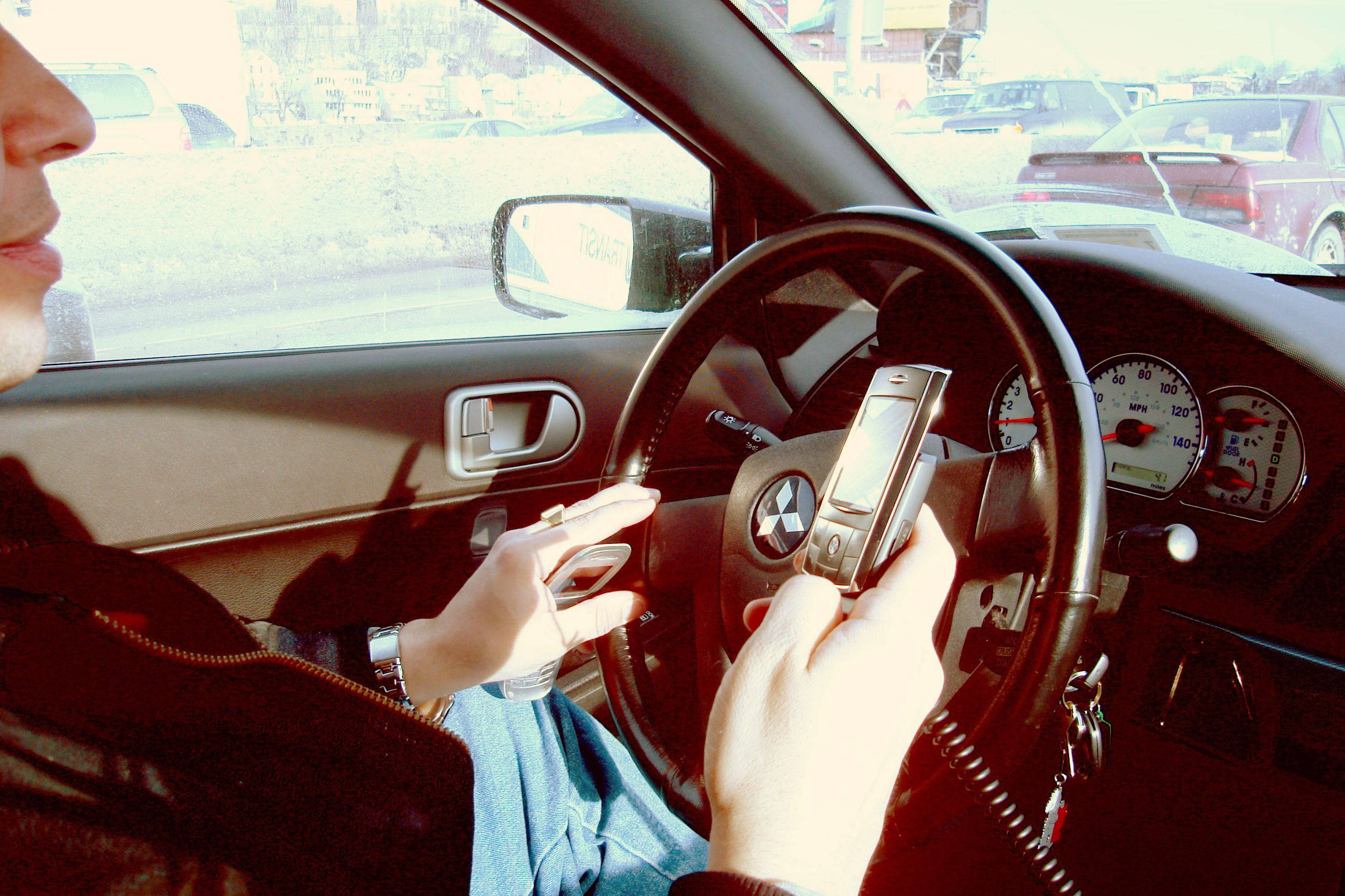 Calls for 'better enforcement against drivers using mobile phones'
