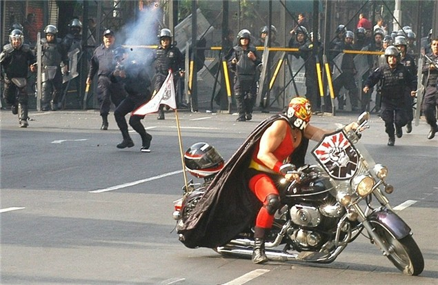 Bike mounted Luchador vs. Mexican riot cops