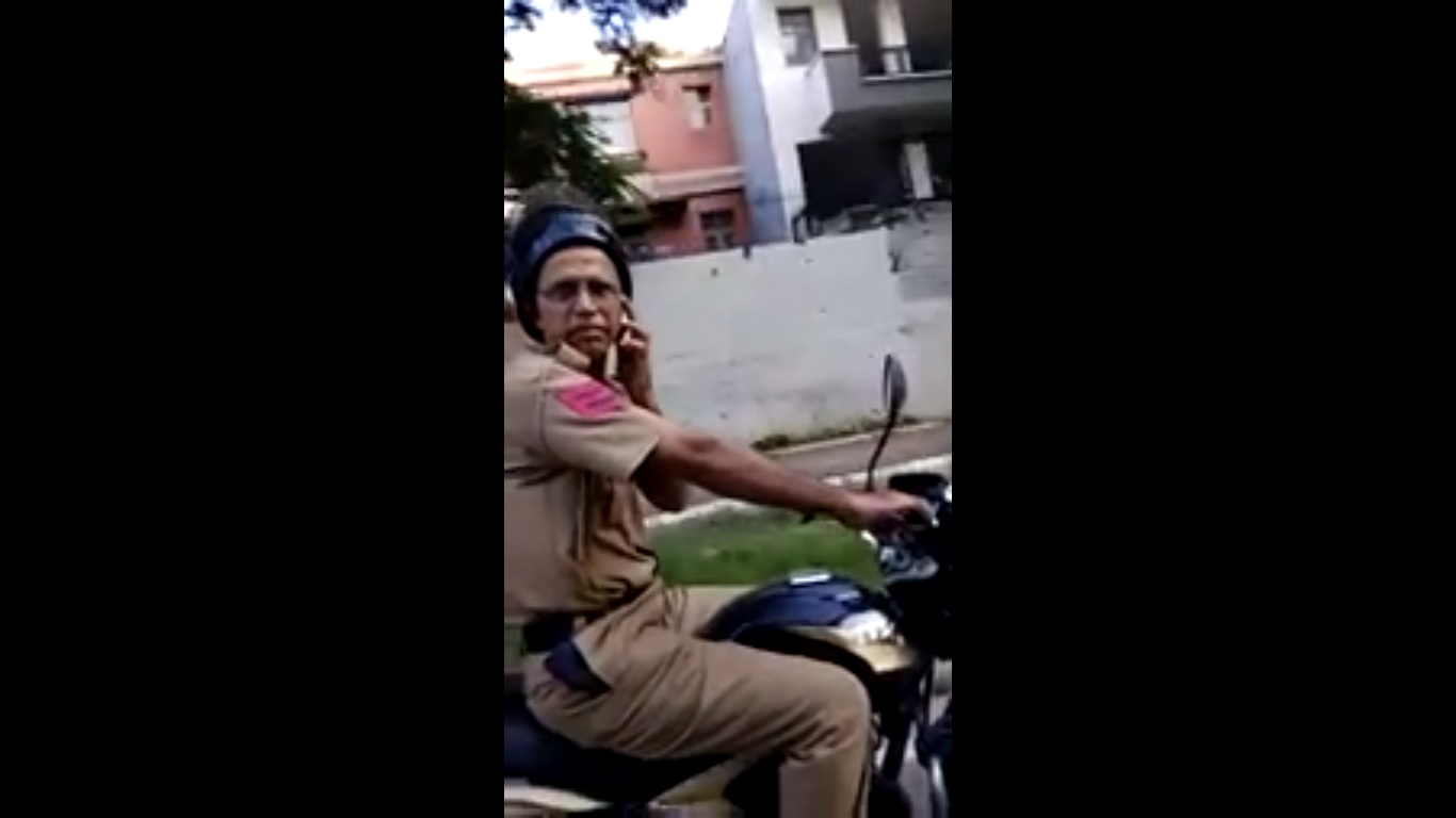 A slap in the face for motorcyclist who confronted cop for using phone while riding
