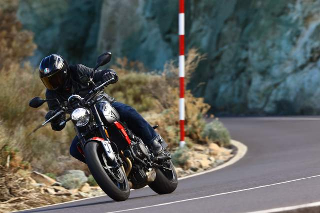 Triumph Trident cornering on a mountain road