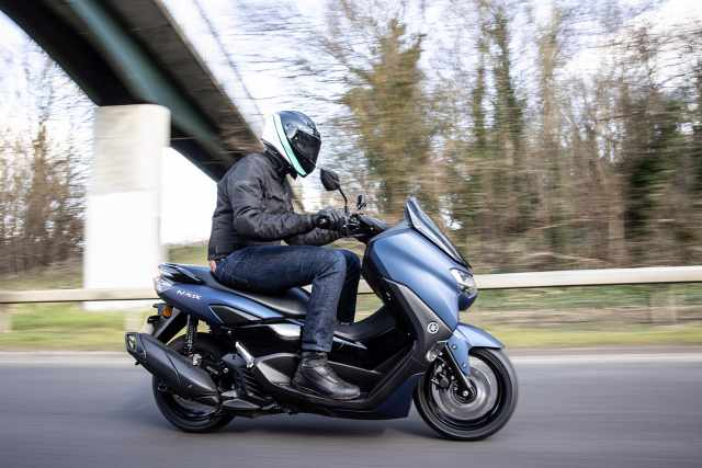 Yamaha NMAX side view on road