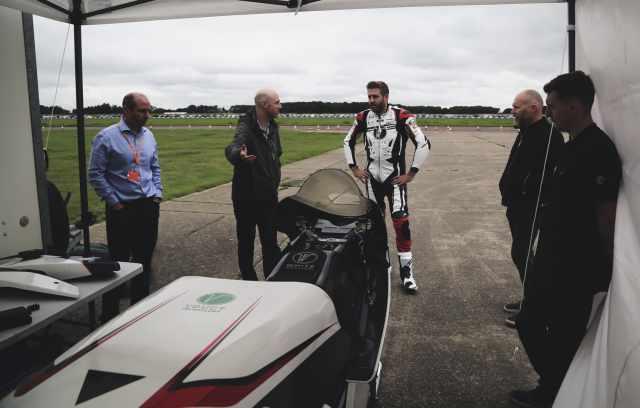 WMC testing electric bike with team