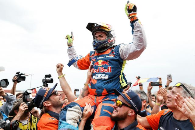 Matthias Walkner celebrates his maiden Dakar win