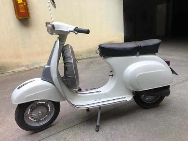 Vespa 50 Special white scooter