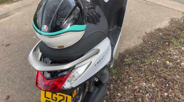 Yamaha Delight rear with helmet