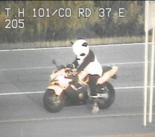 funny motorcycle picture Police pull over motorbike-riding panda