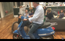 BBC Jeremy Clarkson rides scooter through the office