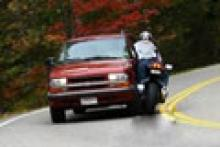 sequence Biker runs wide and strikes car - photo sequence