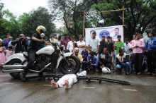Guinness World Records most motorcycles to run over a person
