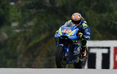 Alex Rins' MotoGP bike catches fire in the Sepang pit lane