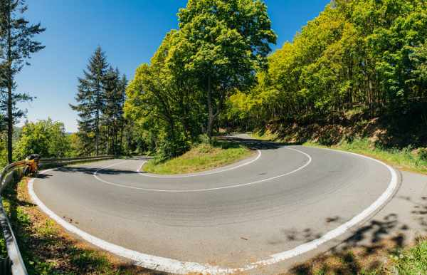 Lunatic pours cooking oil across picturesque hairpin!