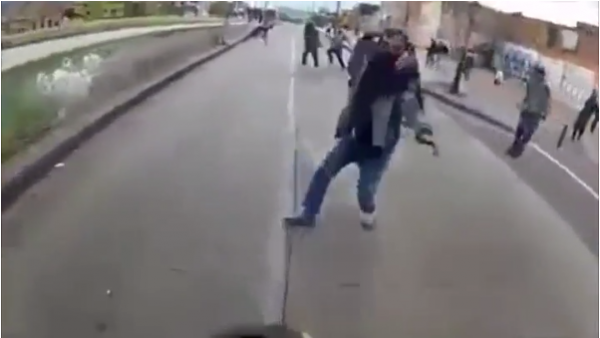 Biker accidentally rides motorcycle into a riot