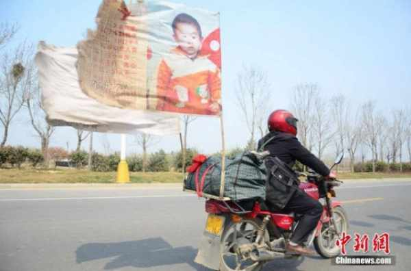 Father discovers son after 500,000km motorcycle search across China