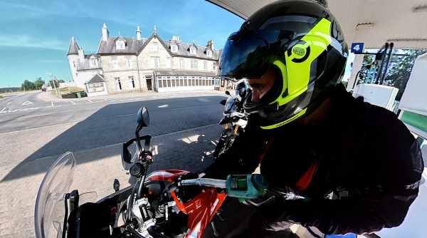 motorcycle refill at petrol station