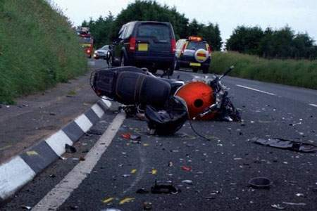 Three police officers charged with dangerous driving after motorcycle crash