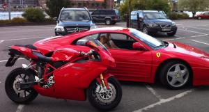 Ducati motorcycle and Ferrari sportscar